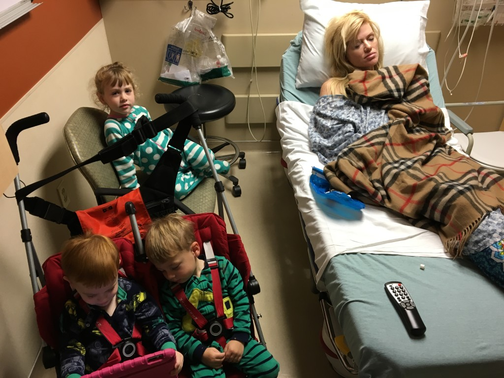(As I was typing this blog entry my husband showed me his IPhone and look what he had! A pic of me and the kids at the ER. I find it amusing now, but I am sure I wouldn't have at that moment, had I known he was taking pics of me on a hospital gurney)