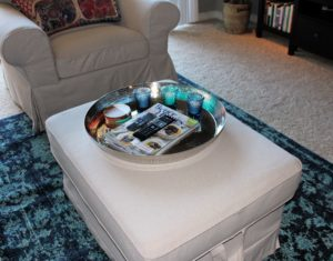 She had already purchased the ottoman so I suggested using that as a coffee table as well by adding a large tray. We then added some candles and her magazines to make it feel like home.